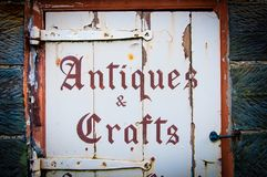 Old wooden sign with Antiques and Crafts Stock Photos