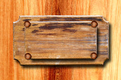 Old wooden sign on the wall of wood Stock Photos
