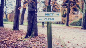 Old Wooden Signpost for Dirty and Clean Concept Royalty Free Stock Photography