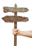 Old wooden signpost on hand Stock Image