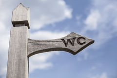Old wooden signpost over blue sky. Stock Photo