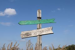 Old wooden signpost with two arrows royalty free stock photos