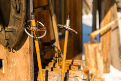 Old wooden ski poles snow winter cottage Royalty Free Stock Images