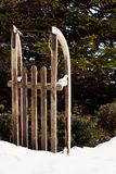Old Wooden Sled Left In The Snow royalty free stock photo