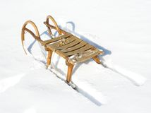 Old wooden sledge. With snow in background Stock Image