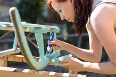 Old wooden sledge is getting painted Royalty Free Stock Photos