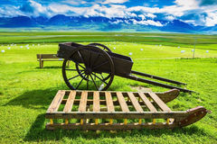 Old wooden sledge on the lawn Royalty Free Stock Images