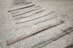 Old wooden sleepers on gravel. Abandoned railroad without rails Royalty Free Stock Images