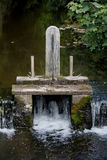 Old wooden sluice gate on a river. Stock Image