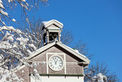 Old wooden snow covered chapel Royalty Free Stock Photography