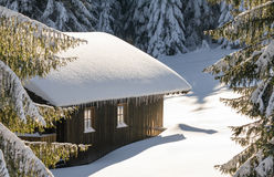 Old wooden snowy ski cabin in the Alps royalty free stock photography
