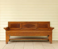Old wooden sofa. On wooden plank wall Stock Photos