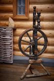 Old wooden spinning wheel Stock Images