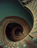 Old wooden spiral stairs in palace Stock Images