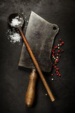 Old wooden spoon and Meat cleaver knife Stock Photo