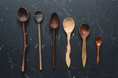 Old wooden spoons on dark background. Top view Royalty Free Stock Photo