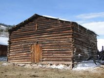 Old wooden stable in winter snow Royalty Free Stock Images