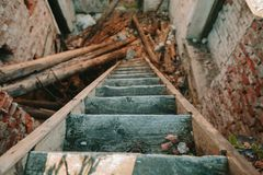 Old wooden staircase descending down. Stock Images