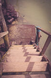 Old wooden staircase leading down to small pier Stock Image