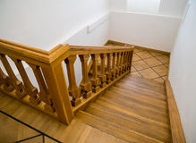 Old wooden staircase with steps going down Royalty Free Stock Photo