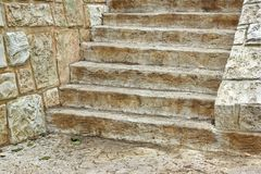 Old Wooden Staircase and stone wall Royalty Free Stock Photo
