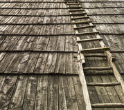 Old wooden staircase on wooden roof.Useful as background Stock Photography