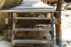 Old wooden stairs. A close up shot of some old weathered beach stairs covered in sand royalty free stock photography