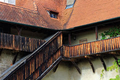 Old wooden stairway and balcony in fortress Royalty Free Stock Photo
