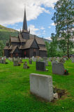Old wooden stave chapel surrounded by cemetery, Norway Royalty Free Stock Photo