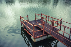 Old wooden and steel made jetty on the lakeside. Old wooden and steel made jetty floating on the lakeside Stock Photo