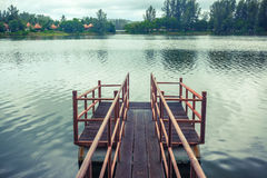 Old wooden and steel made jetty on the lakeside. Old wooden and steel made jetty floating on the lakeside Royalty Free Stock Photo