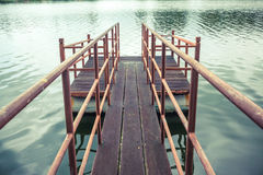 Old wooden and steel made jetty on the lakeside. Old wooden and steel made jetty floating on the lakeside Stock Image