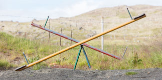 Old wooden and steel seesaw Stock Photo