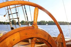 Old wooden steering wheel from the sailing ship stock image