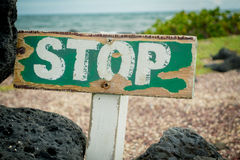 Old wooden stop sign warning about a protected Royalty Free Stock Photography