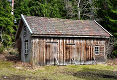 Old wooden store house. Old unpainted wooden store house in Sweden , from the 19th century Royalty Free Stock Photo