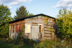 Old wooden summer house with garden in Poland Royalty Free Stock Photos