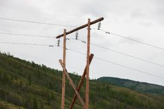 An old wooden support for electric wires. Outdoors Royalty Free Stock Photography