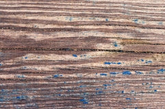 Old wooden surface with the blue exfoliating paint. Textural wooden background Stock Image