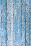 An old wooden surface of blue and white, cracked and weathered paint, background Stock Image