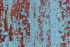 Old wooden surface in a brown colour with pieces of peeling blue. Paint. Background, texture Stock Photography