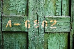 Old wooden surface with cracked green oil-paint Royalty Free Stock Images