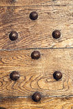 Decorative backgroiund wooden surface with iron rivets. Old wooden surface with grains and rusty iron rivets stock photos