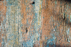 Old wooden painted and peeling surface. Old wooden surface peeling paint red blue Royalty Free Stock Photography