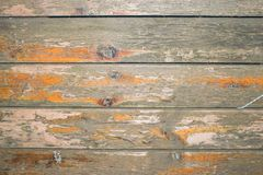 Old wooden surface with peeling varnish and peeling paint. royalty free stock photography