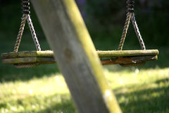 Old wooden swing stock photography