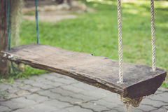 Old wooden swing in the garden Royalty Free Stock Photos