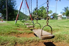 Old wooden swings. In the playground Royalty Free Stock Photos