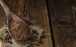 Old wooden table with Allspice powder Stock Photo