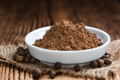 Old wooden table with Allspice powder Stock Photography